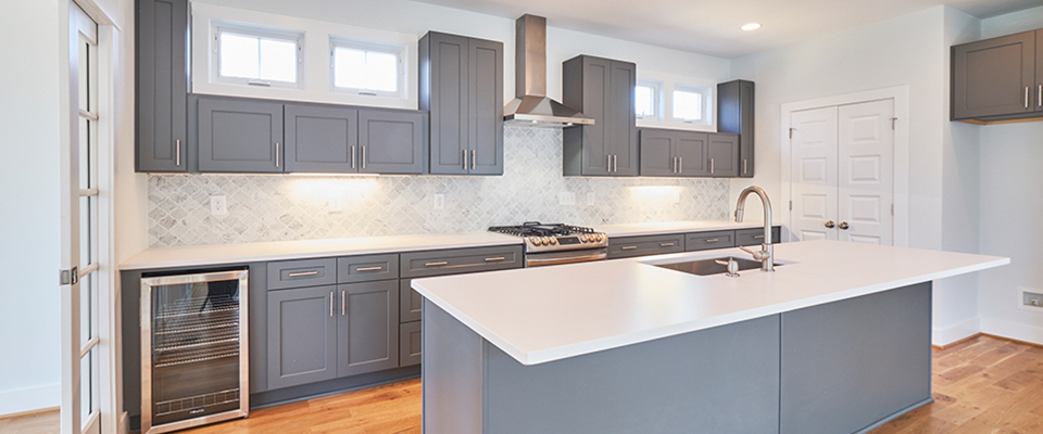 Kitchen with grey cabinets and white countertops