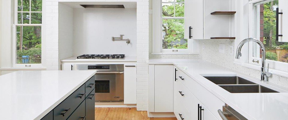 kitchen with white cabinets and countertops